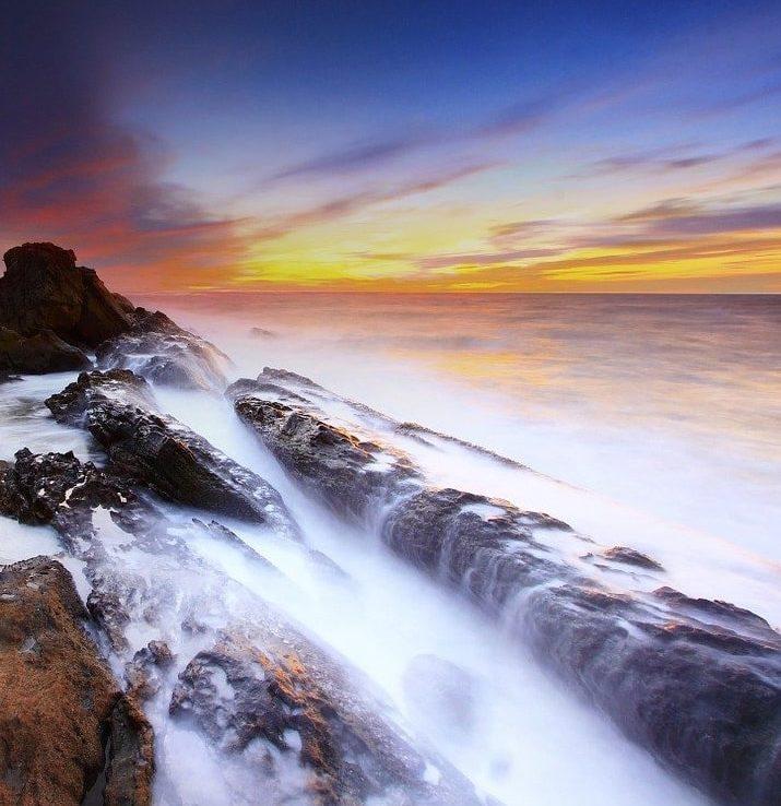 beach waves against rocks